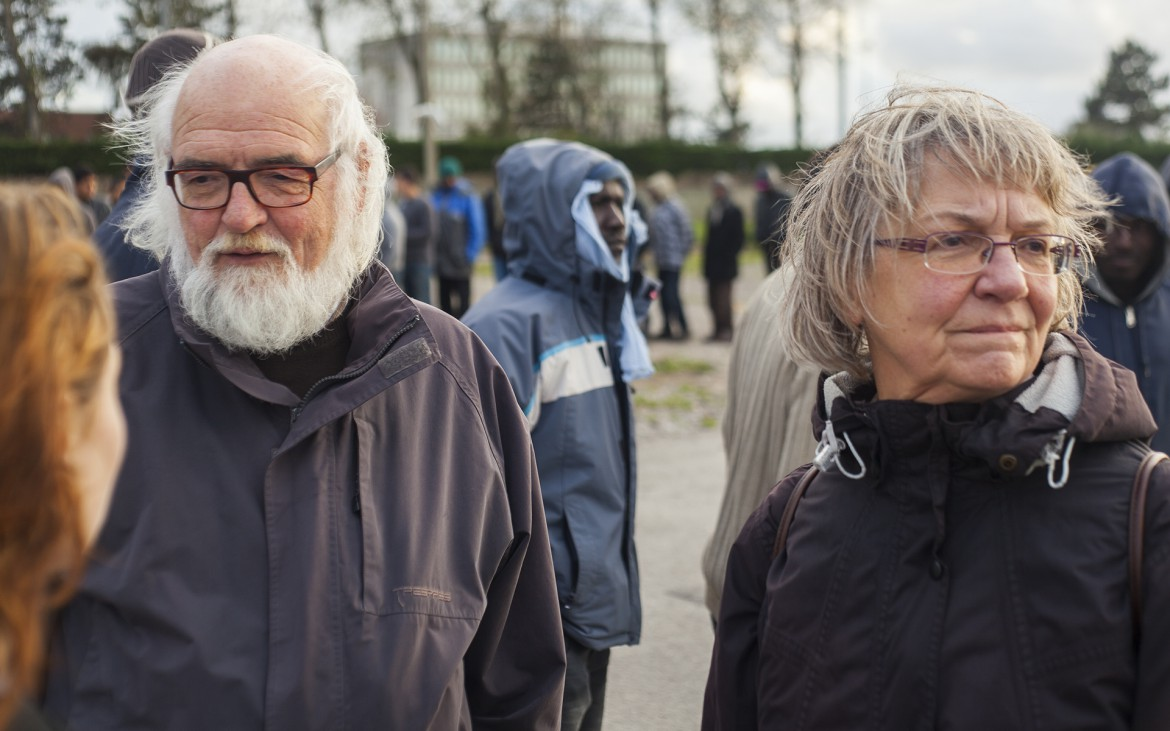 André and Marguerite Vahé Help to protect the migrants and discuss the current situation in Calais.