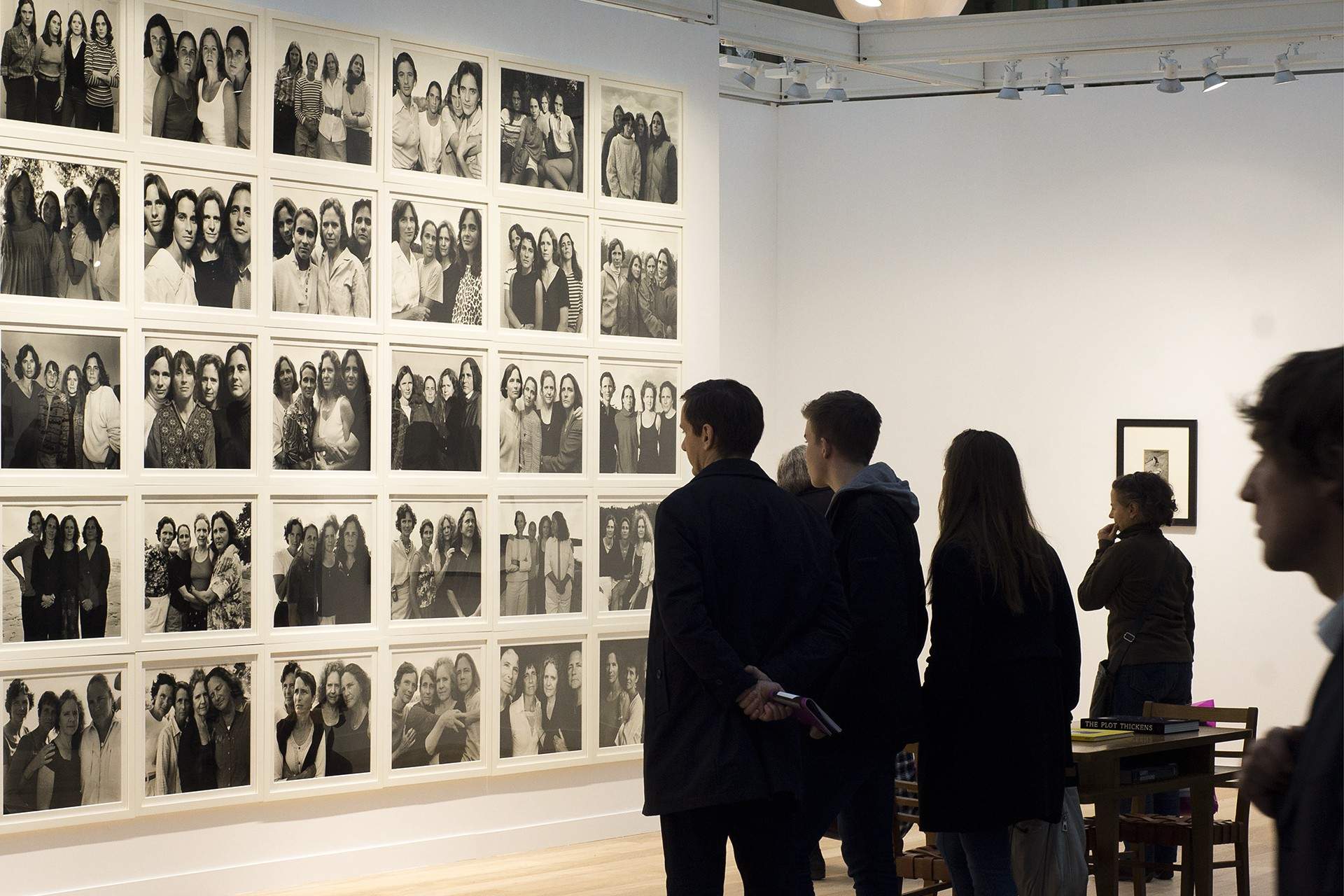 Photographs taken at Paris Photo November 2014 People looking at the Brown Sisters by Nicolas Nixon Photographed by Pieteke Marsden