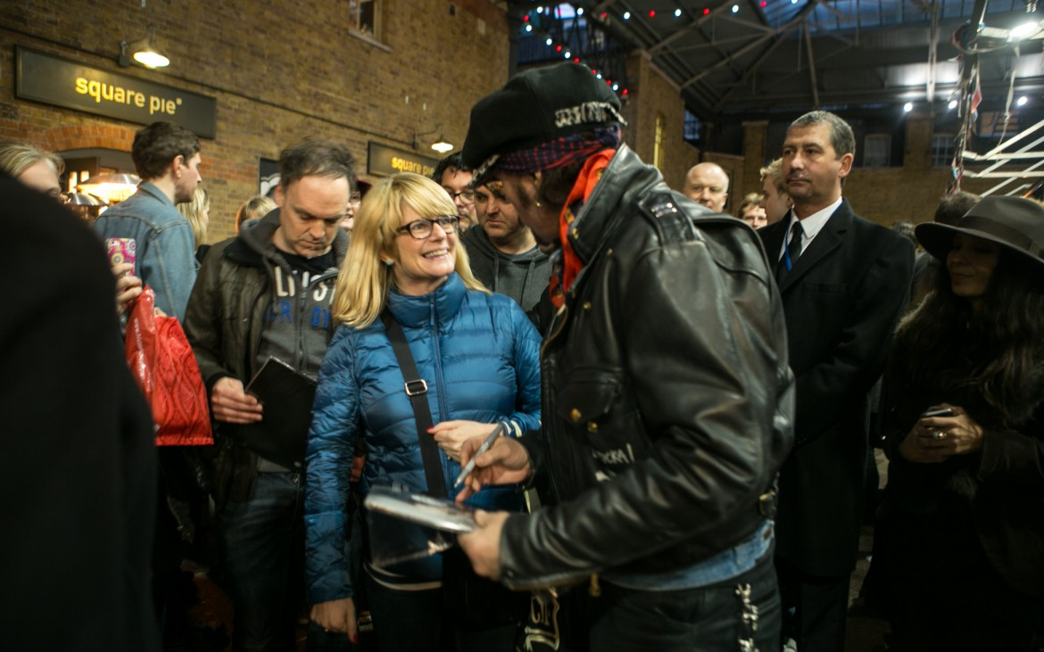 A fan meets post-punk artist Adam Ant at the Independent Label Market in Spitalfields, London. © Lauren Towner