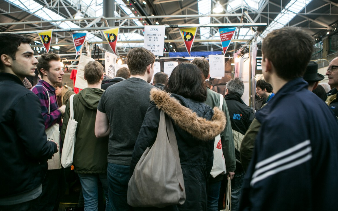 A crowd gathers around the 4AP stall at the bi-annual Independent Label Market in Spitalfields, London. © Lauren Towner