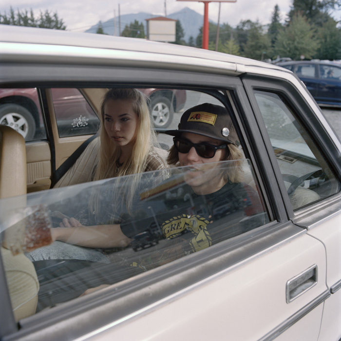 Laura and James in a friend's car at North Bend, Washington,  a place made famous in the <i>Twin Peaks</i> TV series. [Carl Bigmore]