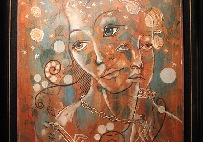 Abstract painting of womens' faces