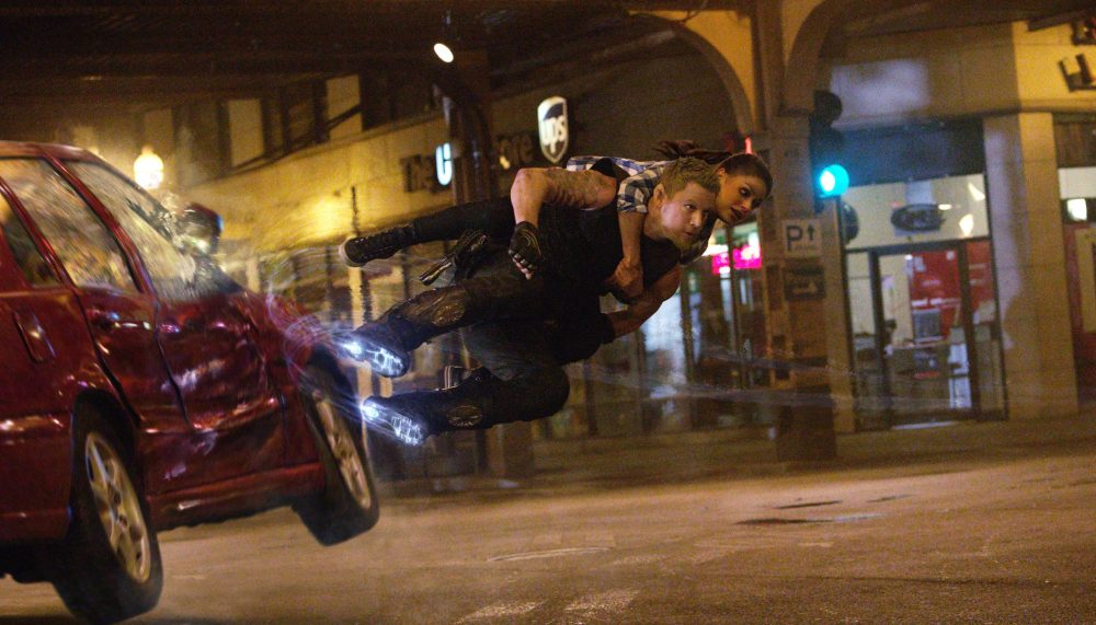 Mila Kunis and Channing Tatum with his anti-gravity boots in Jupiter Ascending. [Warner Bros UK]