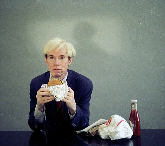 Andy Warhol eats a burger in his 66 Scenes from America