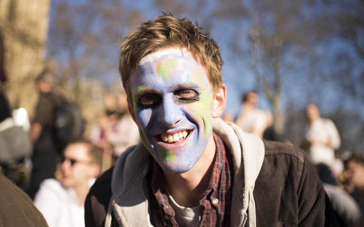 Protestor with painted face. [Elena McDonough]