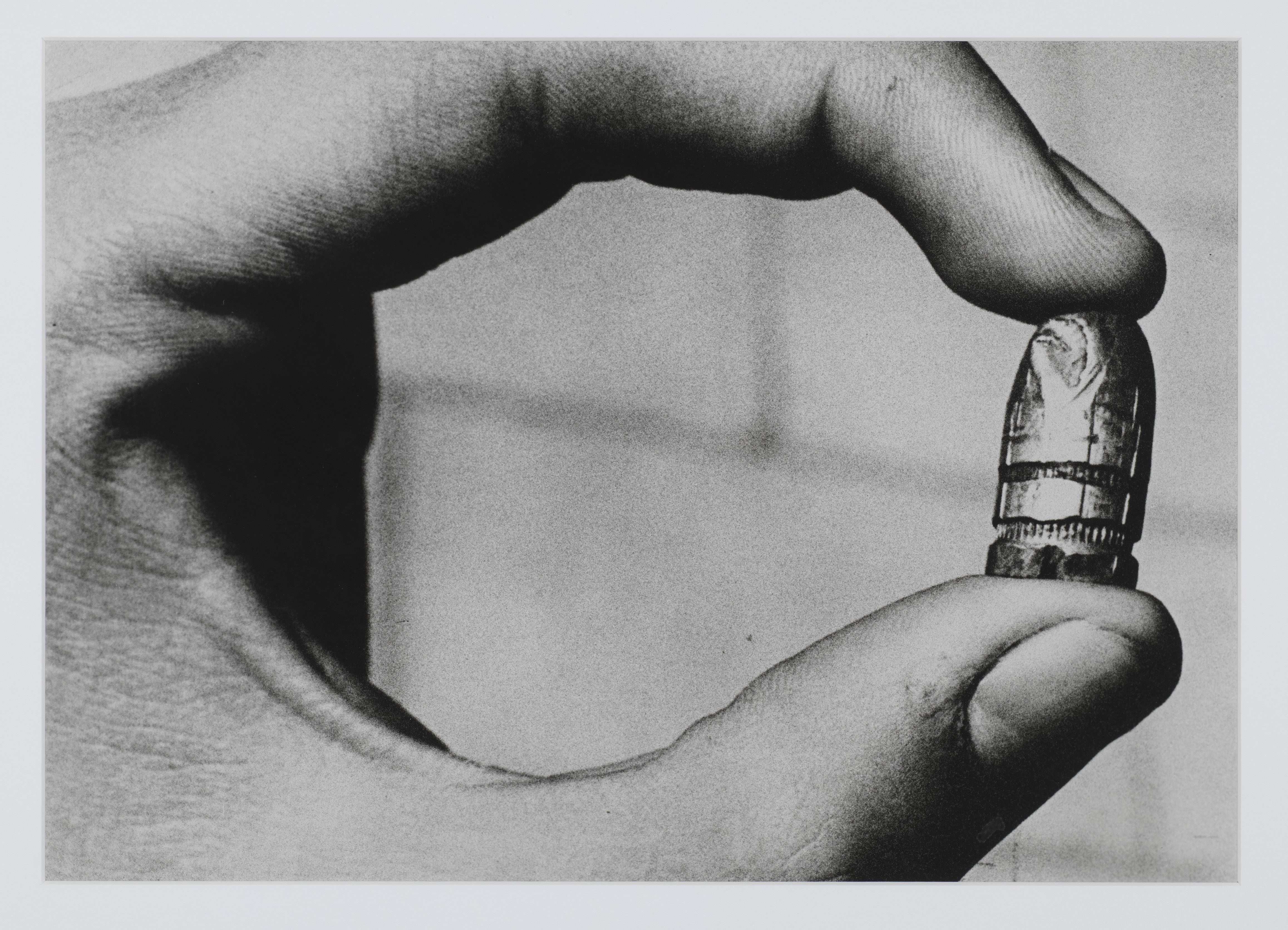 Photograph of a bullet from 'Forensics' exhibition. The photography of Metinides was useful for ballistic experts in matching artillery to the ammunition used at a crime scene.
