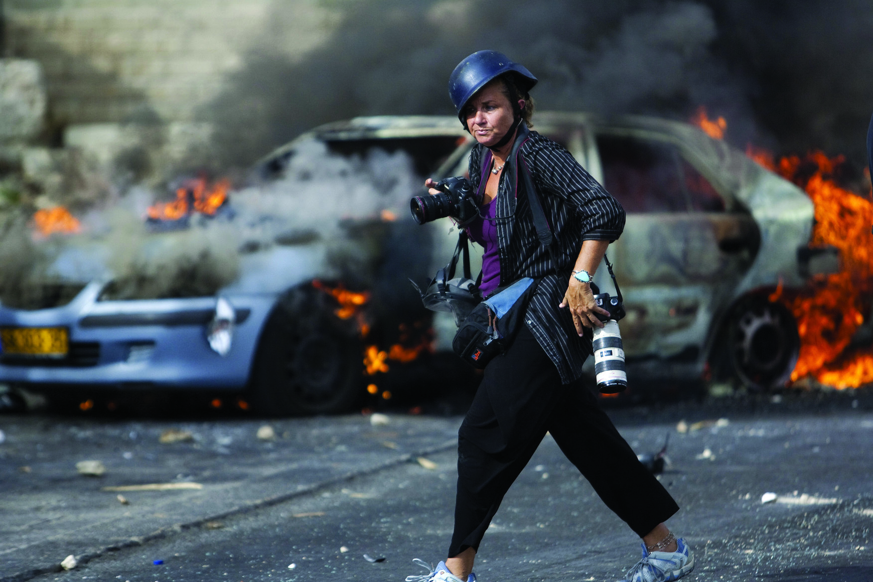 American Photographer Heidi Levine on assignment during clashes in Jerusalem between Palestinians and Israeli forces on September 22,2011. (Photo by Warrick Page).