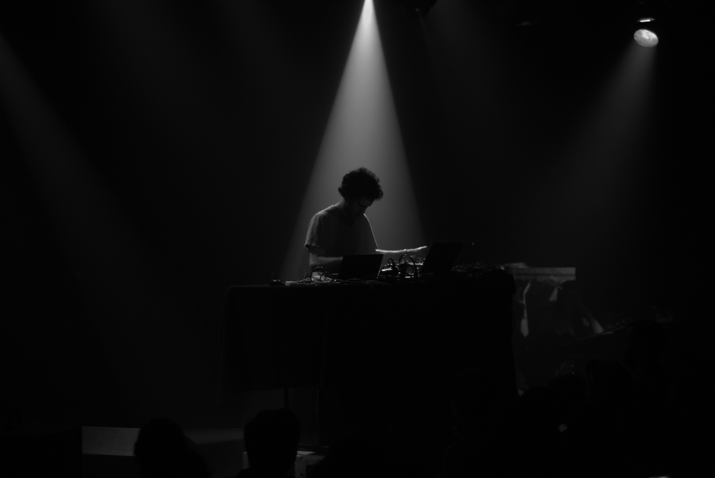 Silhouette of a DJ on stage