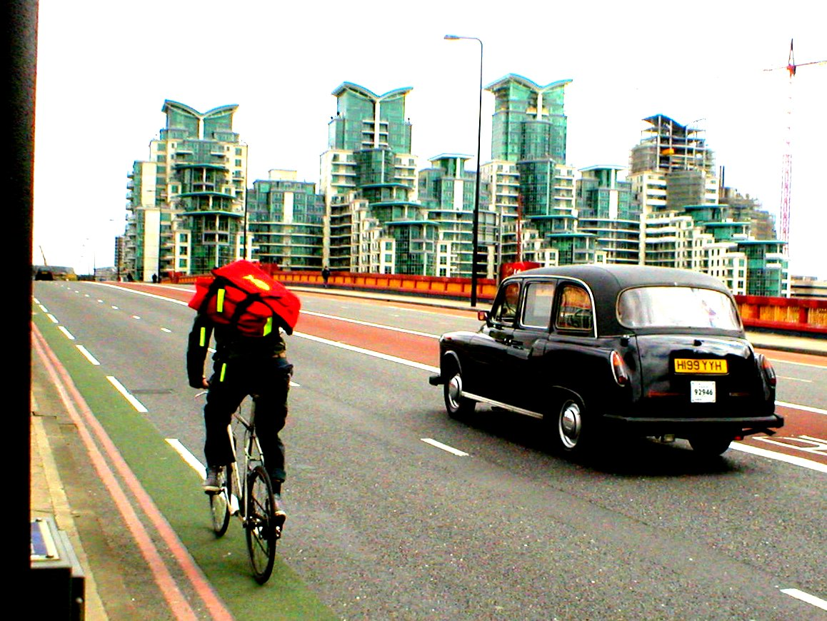 Cycle courier on Vauxhall bridge