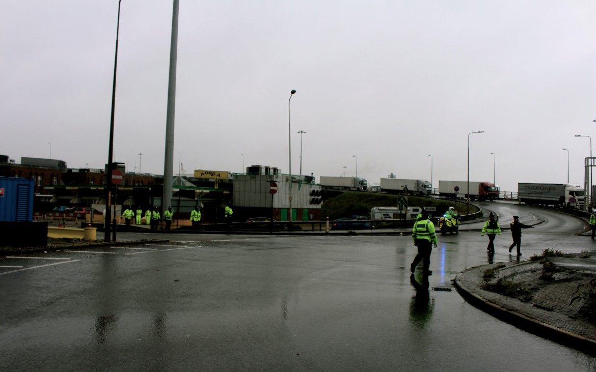 Police emerge from directing the lorries, which came from Calais, and then towards protestors - Photo by Hani Richter
