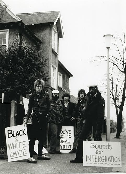 'Demonstrating outside National Front Leader Martin Webster's house, with Steel Pulse, The Clash, and  The Sex Pistols in 1977.' photo Caroline Coon/Camera Press.