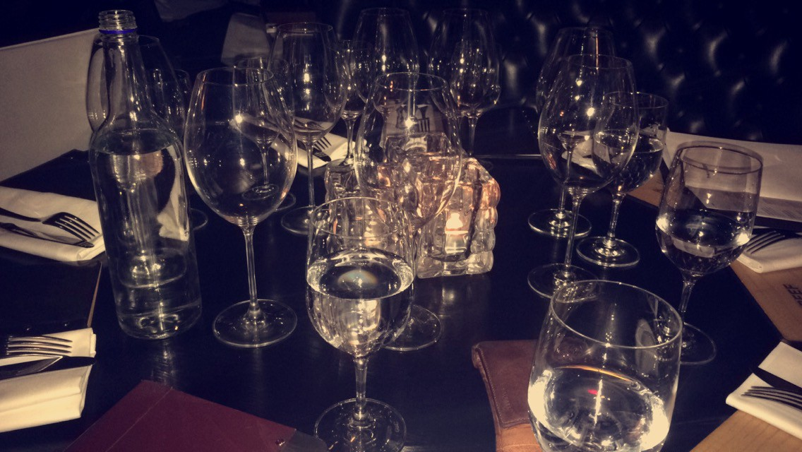 A table top covered in glasses