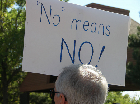 "Placard reads ""No means no"""