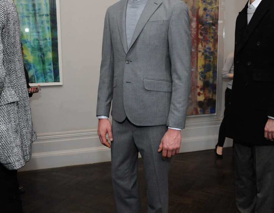 A model in a gray suit