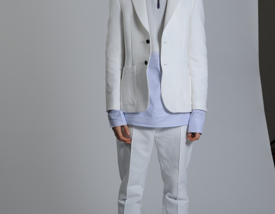 Model in White jacket and jeans