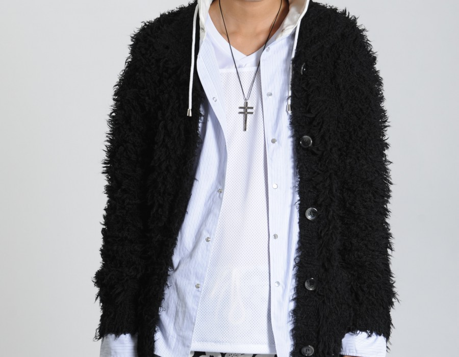 Model in white shirt and black furry coat