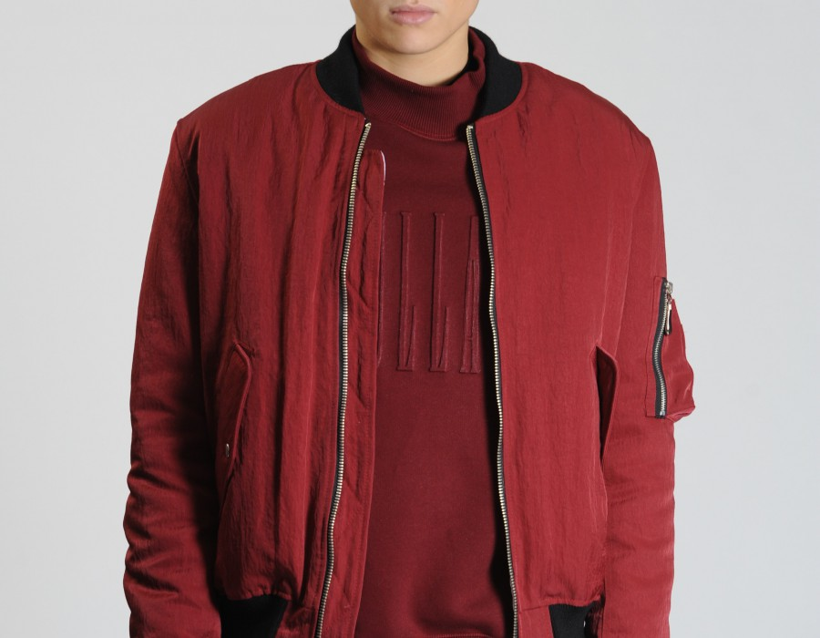 Model in a red bomber jacket