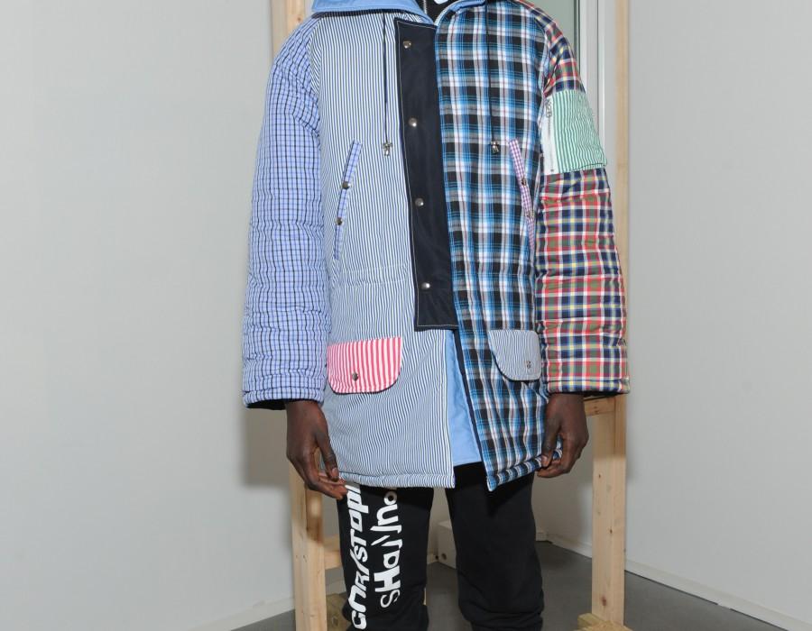 Model in a patchwork coat
