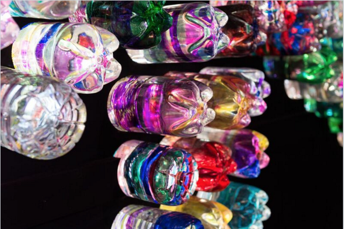 Decorated bottles inside the installation. Photo by Will Eckersley
