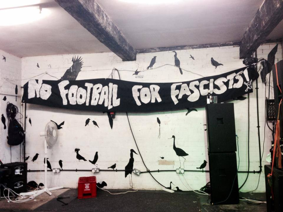 Sign reads No Football for Fascists