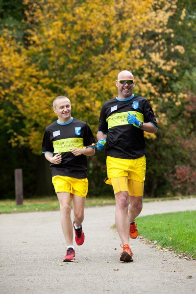 A blind runner and his support runner