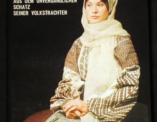 Magazine cover of a woman wearing traditional outfit