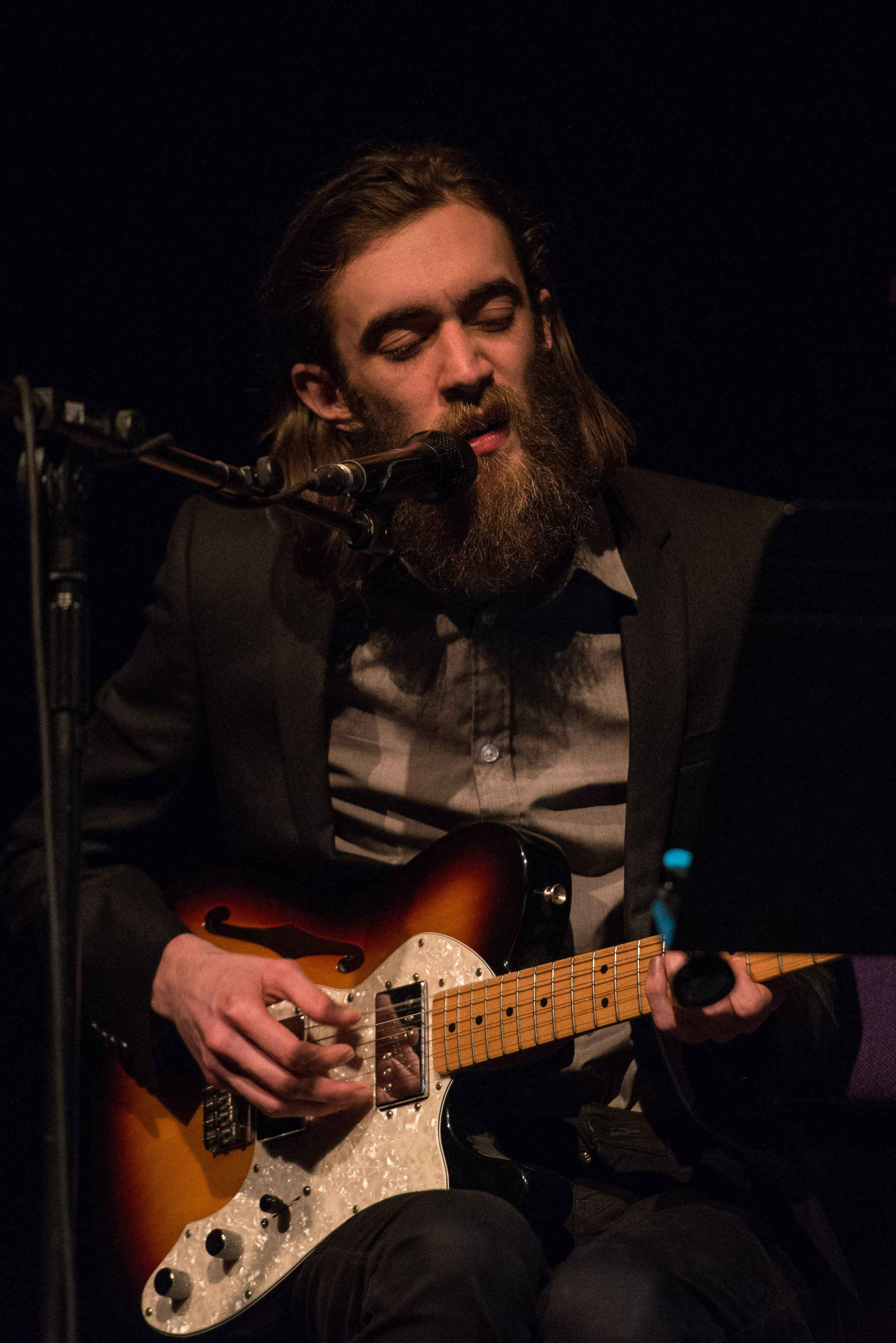 Bearded and slender, Keaton Henson faces his audience head on (Image by Joshua Atkins)