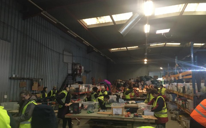 Volunteers working at L'Auberge Warehouse