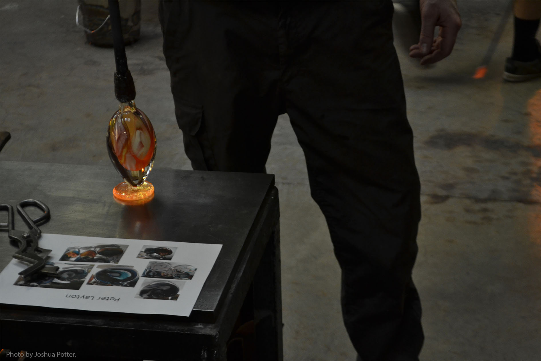 As the piece progresses, two to four people will work on it, adding attachments like a baseplate to any standing piece (see above) and generally helping the main glassblower to complete the work. A piece this size takes about thirty minutes to complete.