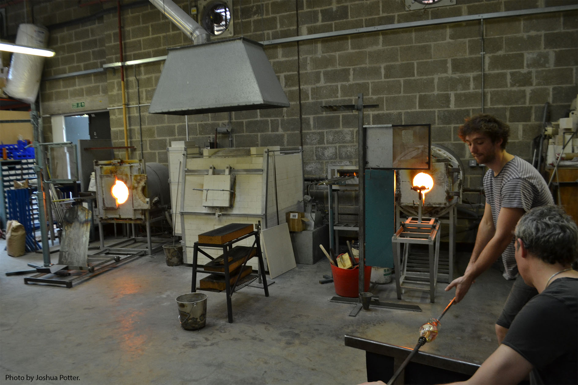The two outside furnaces constantly reheat and remold the piece while the middle furnace, known simply as The Furnace, provides the molten glass used throughout the piece. The glass in this furnace is 1100C.