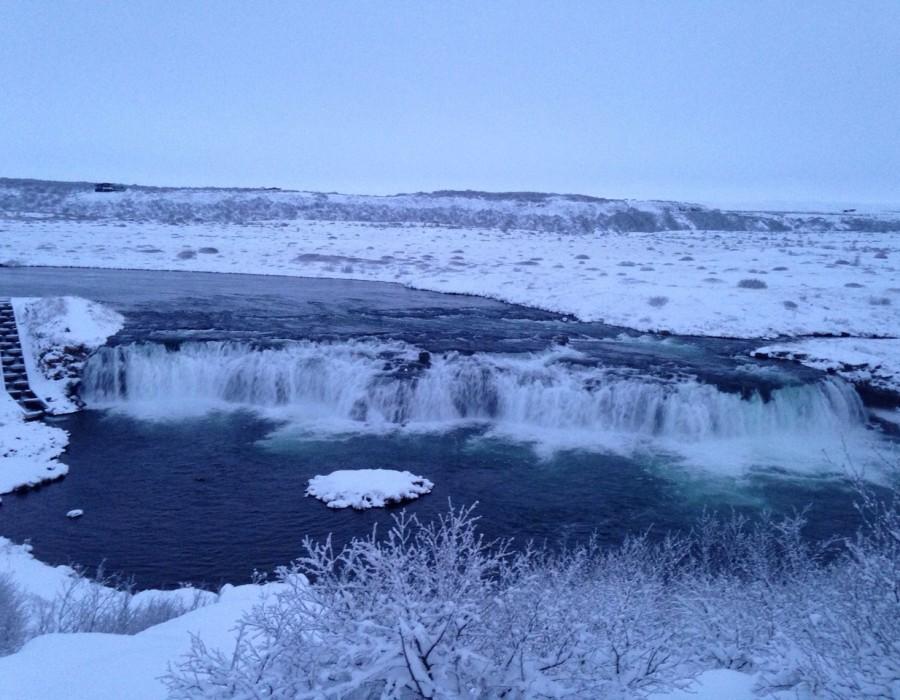 A waterfall in a snowy landscape