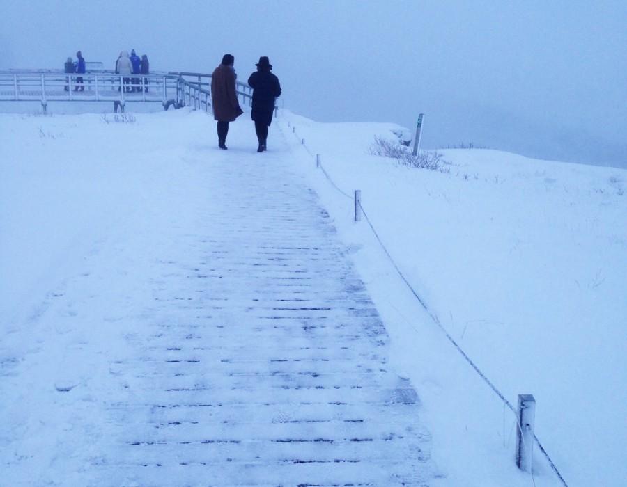 People on an icy boardwalk