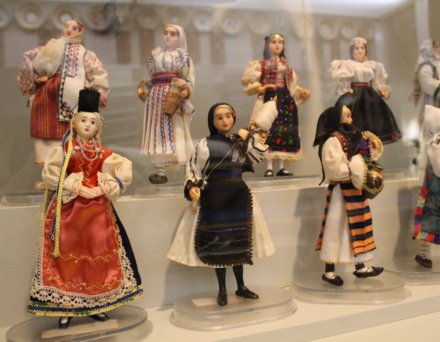 A range of dolls wearing traditional outfits