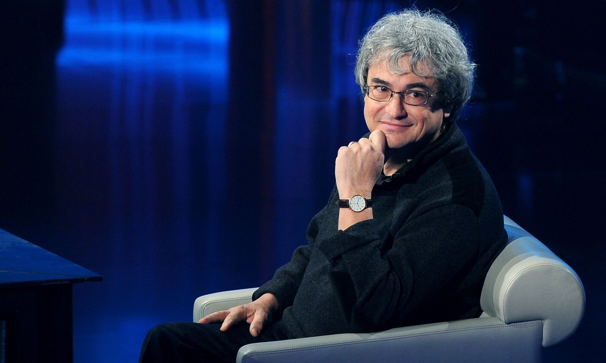 Carlo Rovelli sitting in a chair on TV