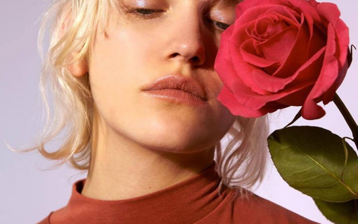 Model posing with a rose
