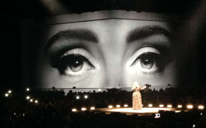 The show started with comeback hit Hello and a giant projection of her bliking eyes, while the singer slowly rose up on a platform at the centre of the arena.