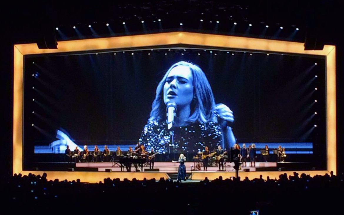 For most of the night Adele's performance was backed by a massive orchestra and backup singers.