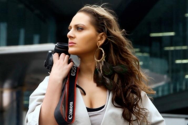 Portrait of Sara holding a camera