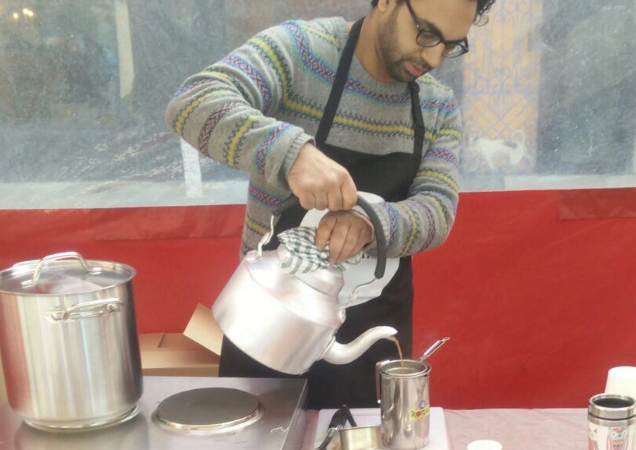 Founder Pranav Chopra pouring chai at his stall in Venn Street market.