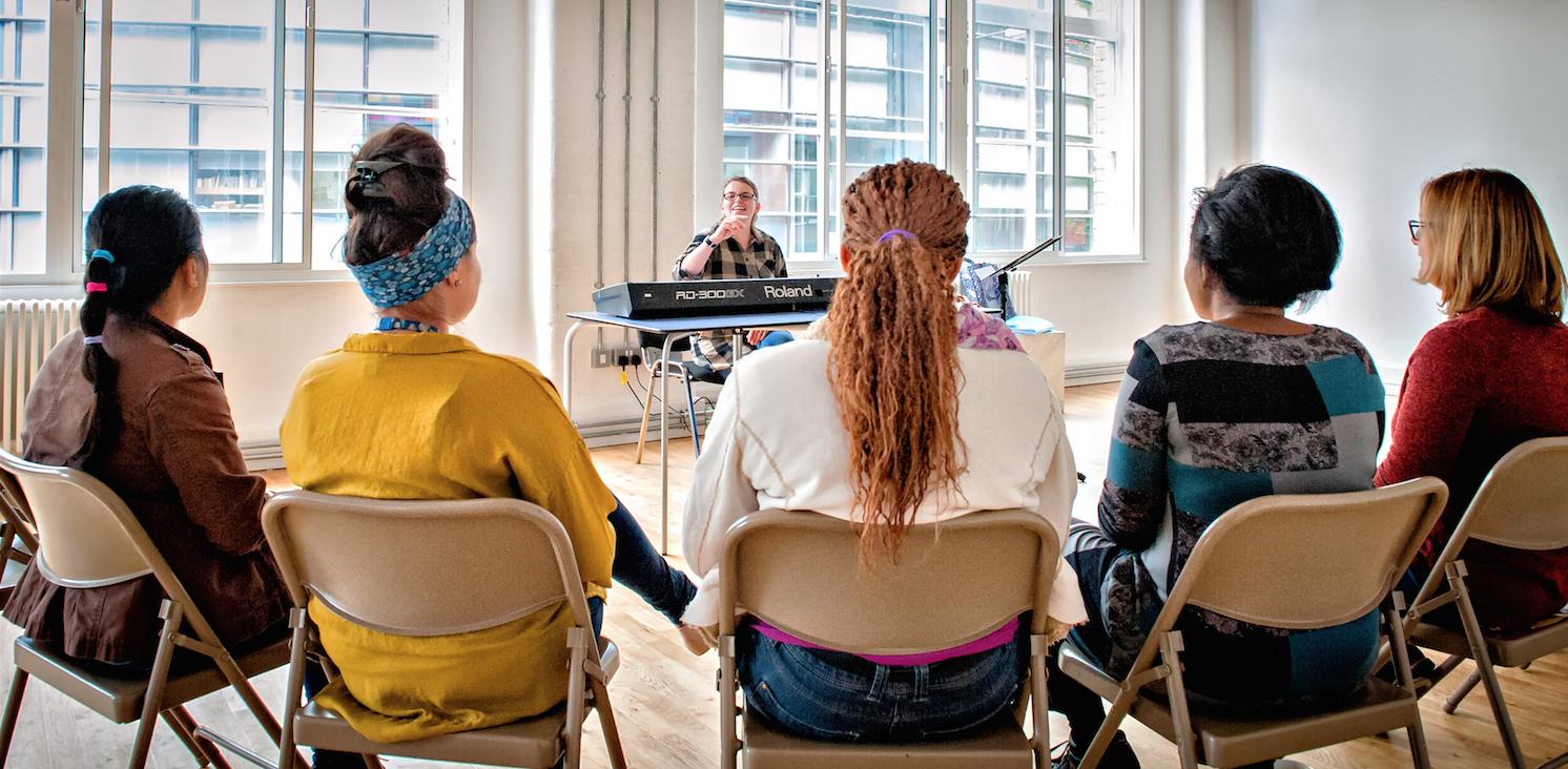 Women refugees singing in a choir in Leeds