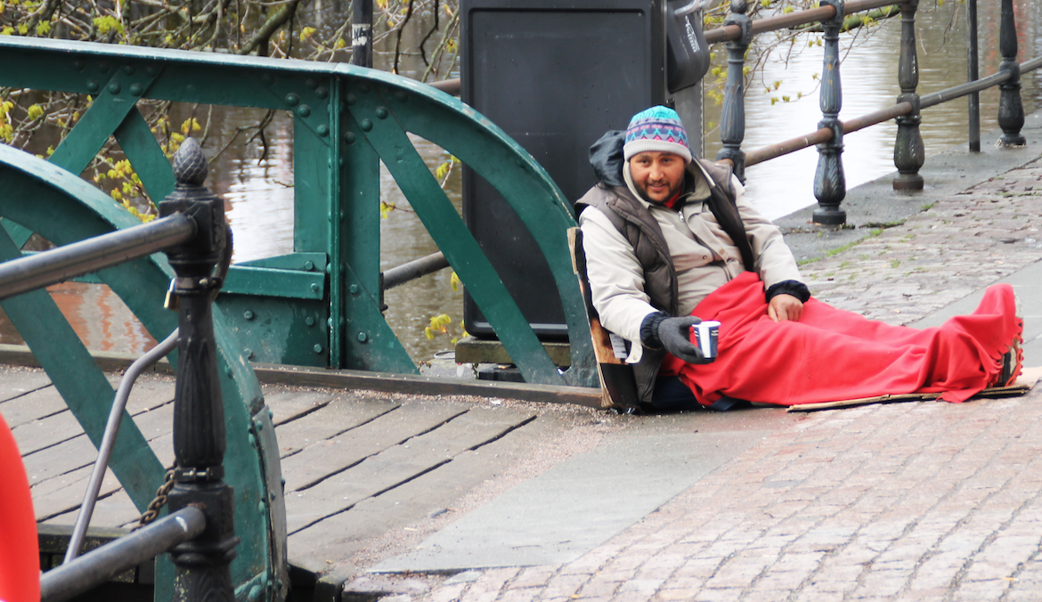 A refugee begging for change in Stockholm