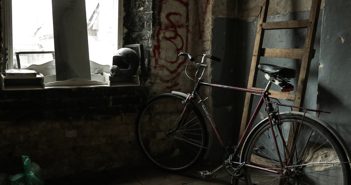A bike and a soldier's helmet in a squat.