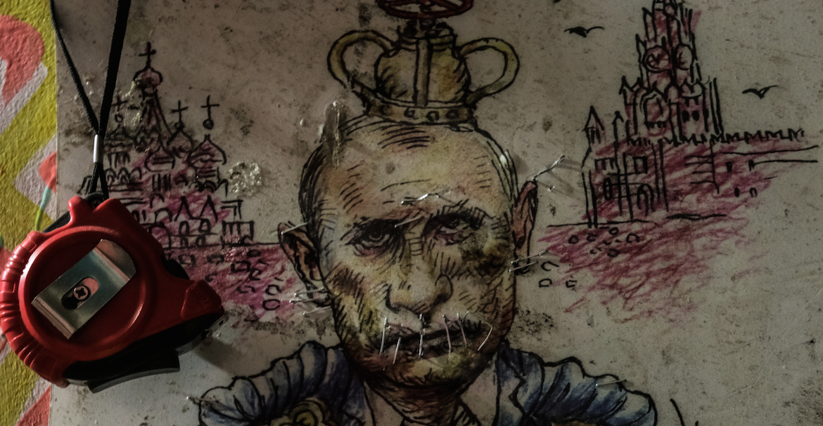 A defaced drawing of Putin on a wall