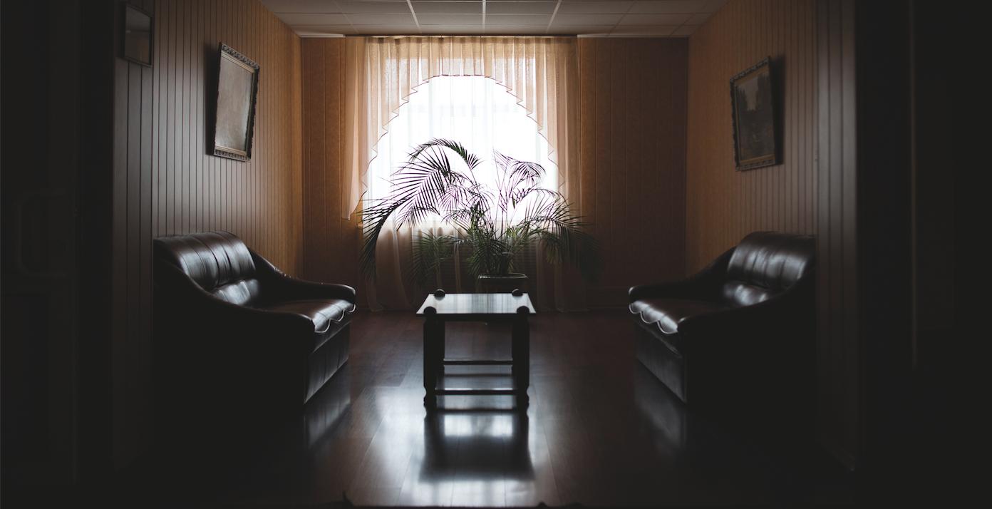 Inside a dimly-lit livingroom in Ukraine