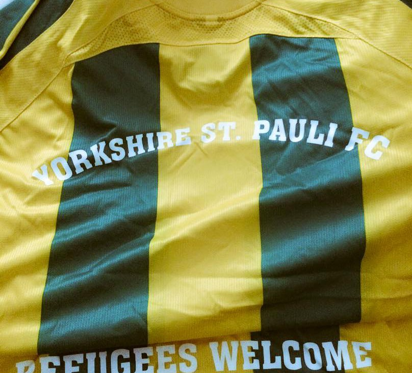 """One of St. Pauli's football shirts stating """"Refugees Welcome"""""""