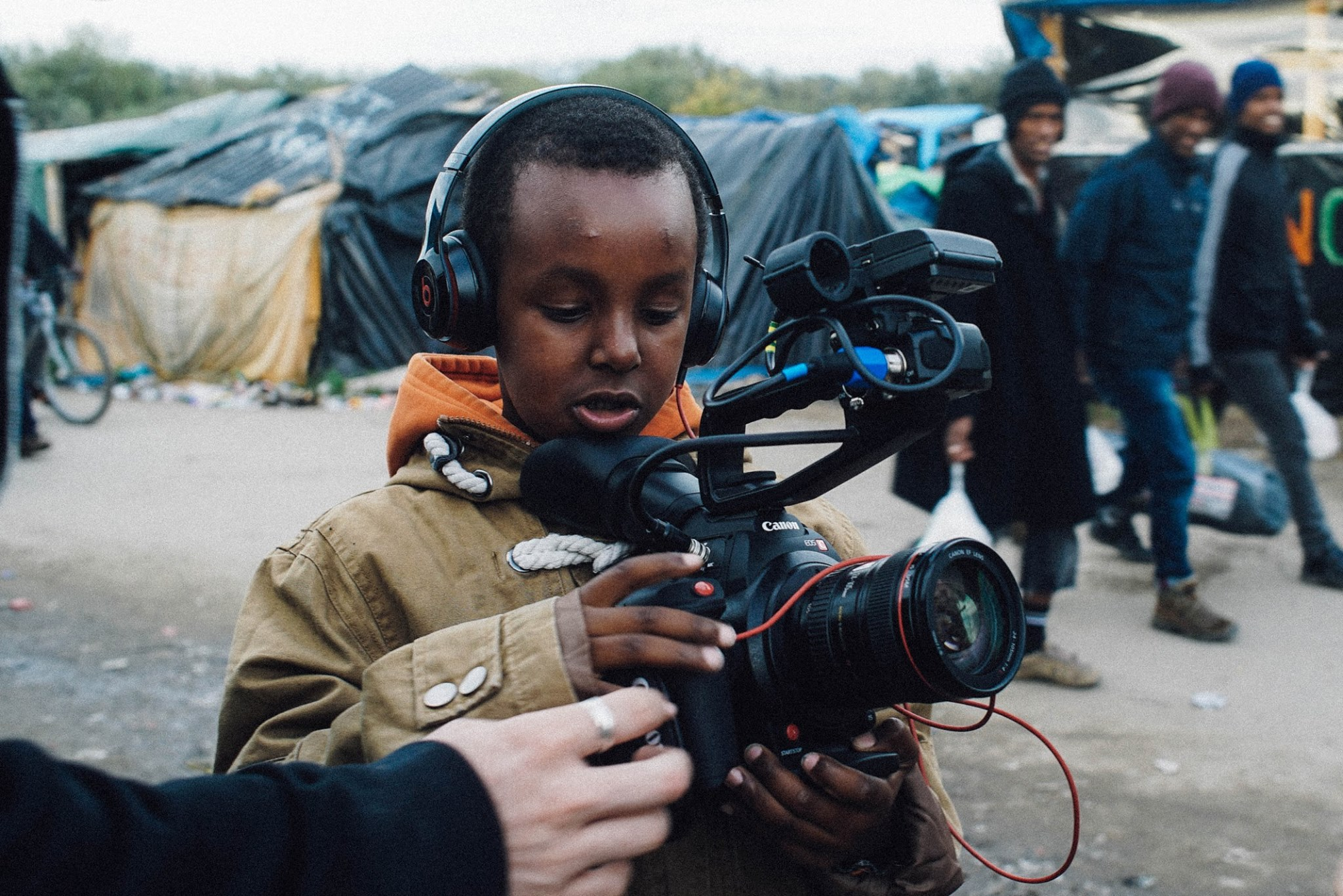 nahom playing with the camera in the jungle camp, in calais