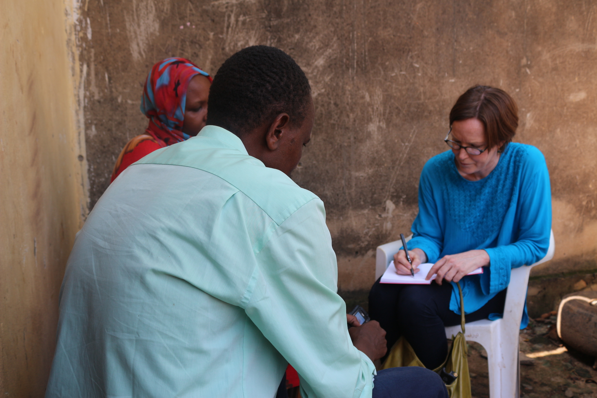 Researcher Joanne Mariner collects testimony in Bangui, Central African Republic, during the conflict, December 2013