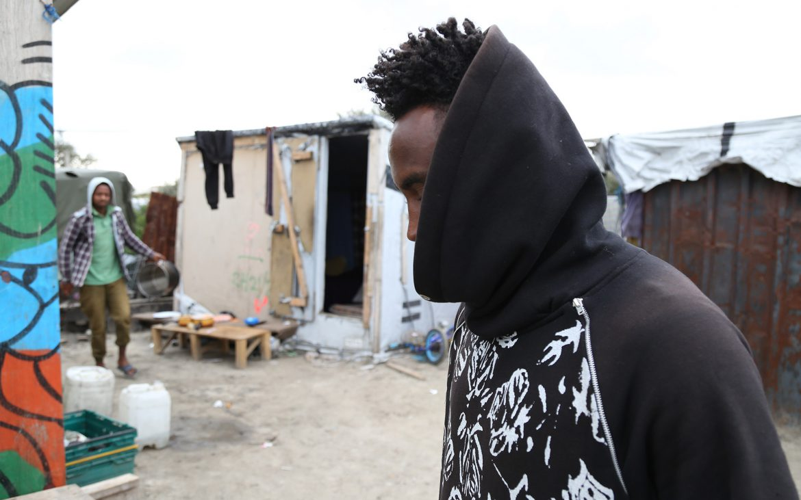 Refugee in the Calais jungle before it was demolished