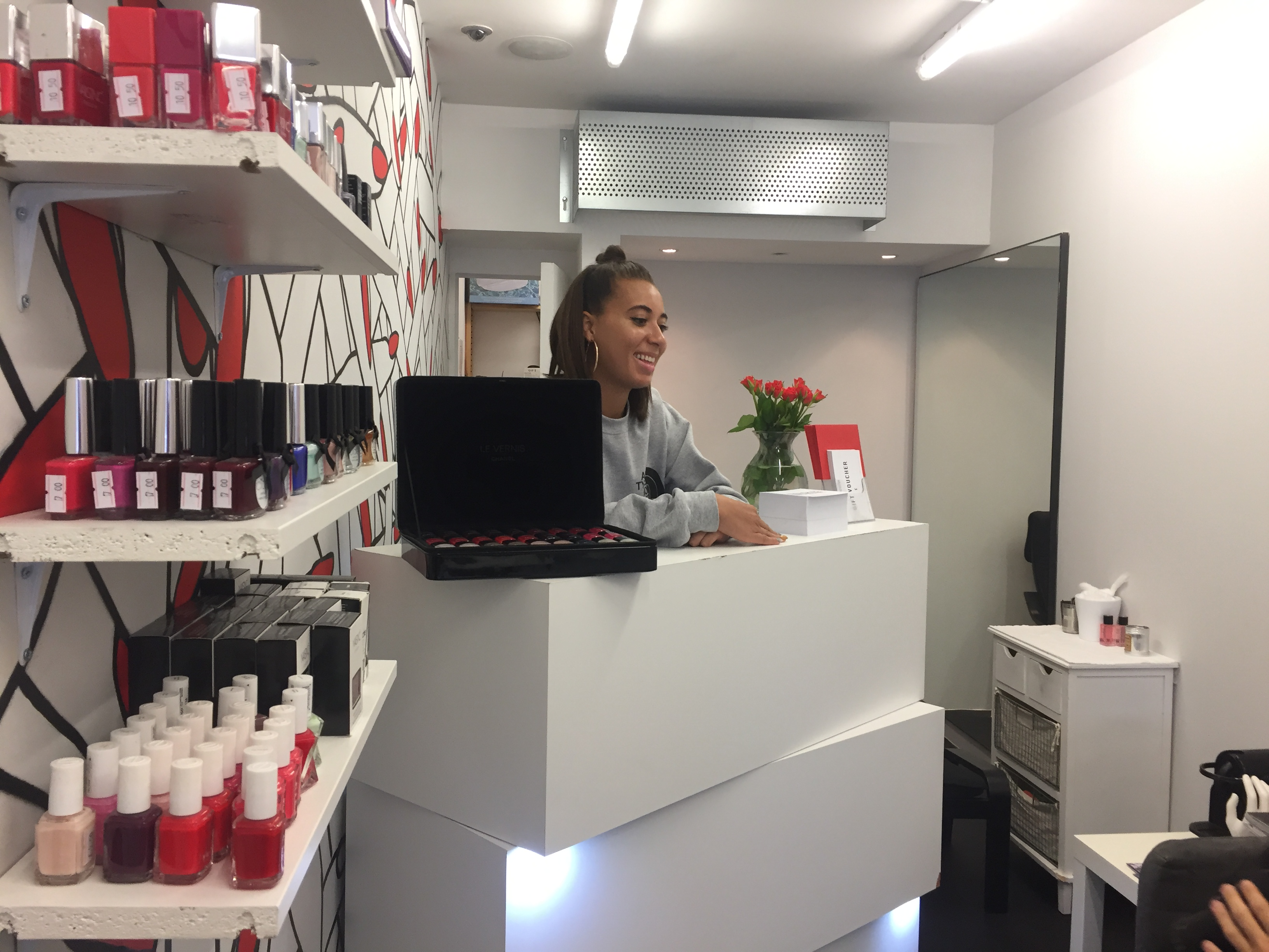 Imarni standing behind the counter in her shop.