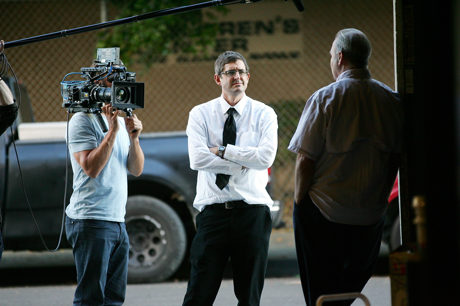 Movie still where Louis Theroux is being filmed for his documentary.